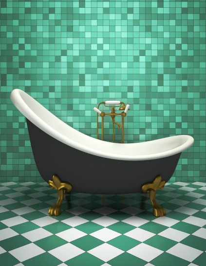 green tiled bathroom with antique tub
