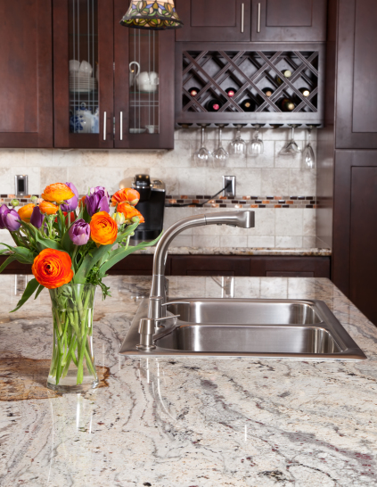 beautiful granite countertop with a vase of flowers